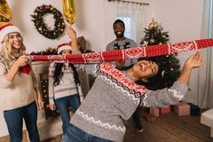 Multiethnic friends playing limbo game Royalty Free Stock Images