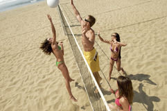Multiethnic Friends Playing Volleyball On Beach Royalty Free Stock Photos