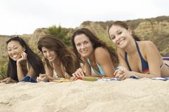 Multiethnic Friends Relaxing At Beach Royalty Free Stock Image