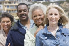 Multiethnic Friends Standing In A Row Stock Photo