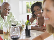 Multiethnic Friends With Wineglasses At Table Royalty Free Stock Photos
