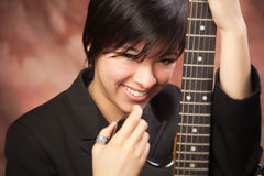 Multiethnic Girl Poses with Electric Guitar royalty free stock images