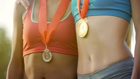 Multiethnic girls taking top places in championship, international competition stock image