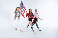 Multiethnic girls walking with american flag and celebrating 4th july royalty free stock photo