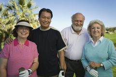 Multiethnic Golfers Standing Together stock image
