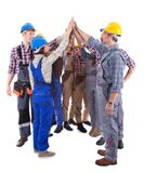 Multiethnic group of artisans doing a high five Stock Images