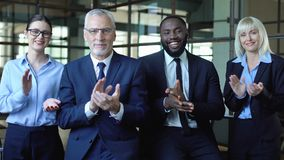 Multiethnic group of business people applauding looking camera, congratulations. Stock footage stock footage