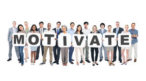 Multiethnic Group of Business People Holding Word Motivate.  Stock Images