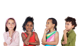 Multiethnic group of children thinking Royalty Free Stock Photography