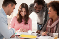 Multiethnic Group of College Students Studying Together Royalty Free Stock Photos