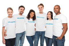 Multiethnic group of volunteers. Multiethnic group of embracing volunteers looking at camera isolated on white Royalty Free Stock Images