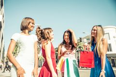 Beautiful women shopping. Multiethnic group of girls shopping - Four beautiful women having fun while buying some presents in a mall in Beverly Hills Royalty Free Stock Photography