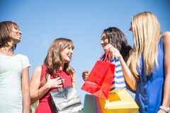Beautiful women shopping. Multiethnic group of girls shopping - Four beautiful women having fun while buying some presents in a mall in Beverly Hills Royalty Free Stock Photo