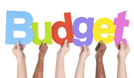 Multiethnic Group of Hands Holding Budget Stock Photography