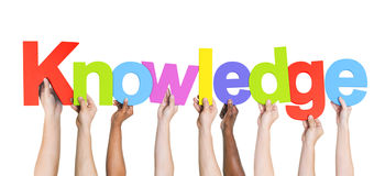 Multiethnic Group of Hands Holding Knowledge Stock Photography