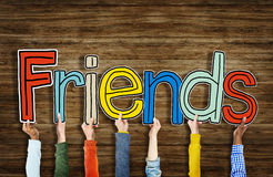 Multiethnic Group of Hands Holding Letter Friends Stock Image