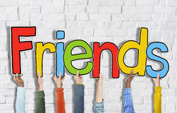 Multiethnic Group of Hands Holding Letter Friends Stock Photos