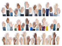Multiethnic Group of Hands Raised Royalty Free Stock Images