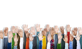 Multiethnic Group of Hands Raised Stock Photography