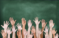 Multiethnic Group of Hands Raised with Blackboard Royalty Free Stock Image