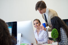 Multiethnic group of happy business people working with laptop computer in office royalty free stock photo