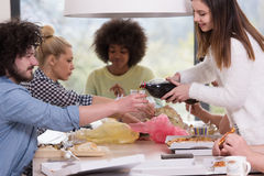 Multiethnic group of happy friends lunch time Stock Images