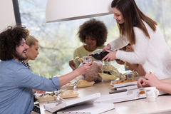 Multiethnic group of happy friends lunch time Royalty Free Stock Image