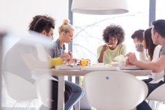 Multiethnic group of happy friends lunch time Stock Photo