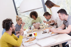 Multiethnic group of happy friends lunch time Royalty Free Stock Photo