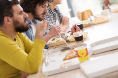 Multiethnic group of happy friends lunch time Royalty Free Stock Photography