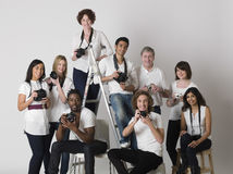 Multiethnic Group Of People With Cameras Royalty Free Stock Images