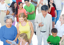 Multiethnic Group of People with Digital Devices Social Media Royalty Free Stock Image