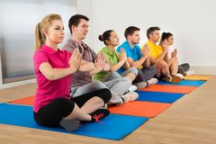 Multiethnic group of people doing meditation Stock Images