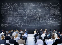 Multiethnic Group of People with Formula on Chalkboard Royalty Free Stock Photo