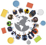 Multiethnic Group of People with Globe Symbol Stock Images