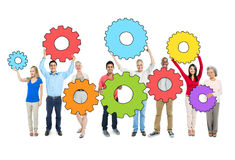 Multiethnic Group of People Holding the Gears Royalty Free Stock Photos