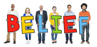 Multiethnic Group of People Holding Letter Belief.  Royalty Free Stock Image