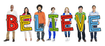 Multiethnic Group of People Holding Letter with Believe Concept Stock Photo