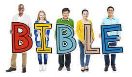 Multiethnic Group of People Holding Letter Bible Royalty Free Stock Images