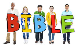 Multiethnic Group of People Holding Letter Bible Concept Stock Photography