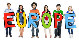 Multiethnic Group of People Holding Letter Europe stock images