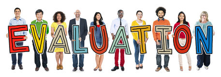 Multiethnic Group of People Holding Letter Evaluation Royalty Free Stock Photo