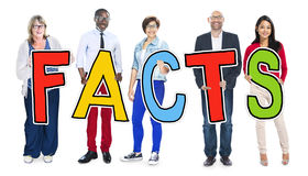 Multiethnic Group of People Holding Letter Facts.  stock photography