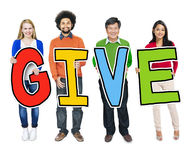 Multiethnic Group of People Holding Letter with Give Concept Stock Image