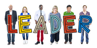 Multiethnic Group of People Holding Letter Leader Stock Photo