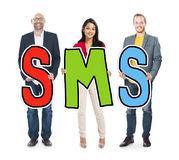 Multiethnic Group of People Holding Letter SMS Concept Stock Photo