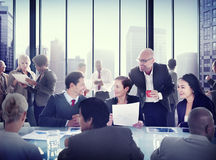 Multiethnic Group of People Meeting in the Office Stock Images