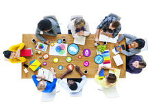 Multiethnic Group of People Meeting with Symbol Stock Photos