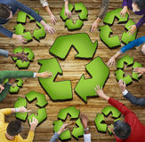 Multiethnic Group of People with Recycling Symbol Stock Images