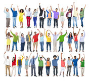Multiethnic Group of People in a Row with Arms Raised Stock Photo